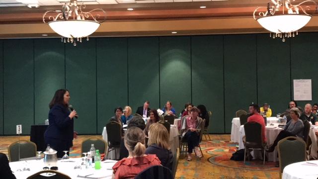 Lori Crowder addressing meeting attendees